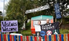 Jamie Watson and Jodie, activists at the Faslane peace camp, outside the Trident naval base